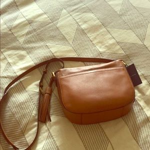 Brand new Cole Haan crossbody/saddle purse.